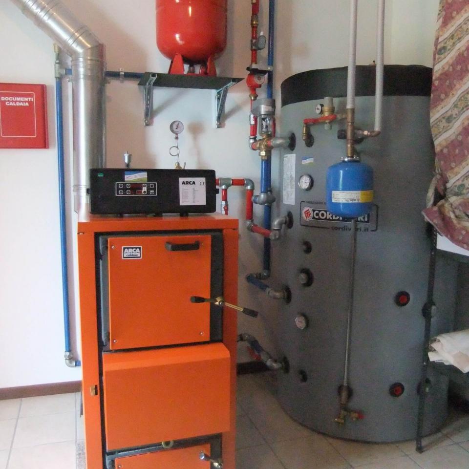 Realizzazione Idraulica Menatti - caldaia biomassa